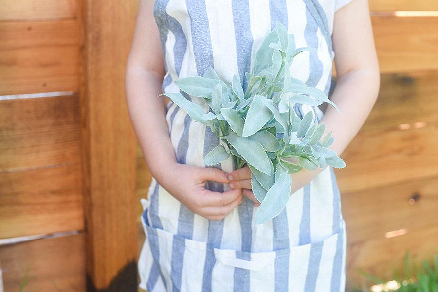 Make A Kid's Farmhouse Apron From A $1 IKEA Dish Towel
